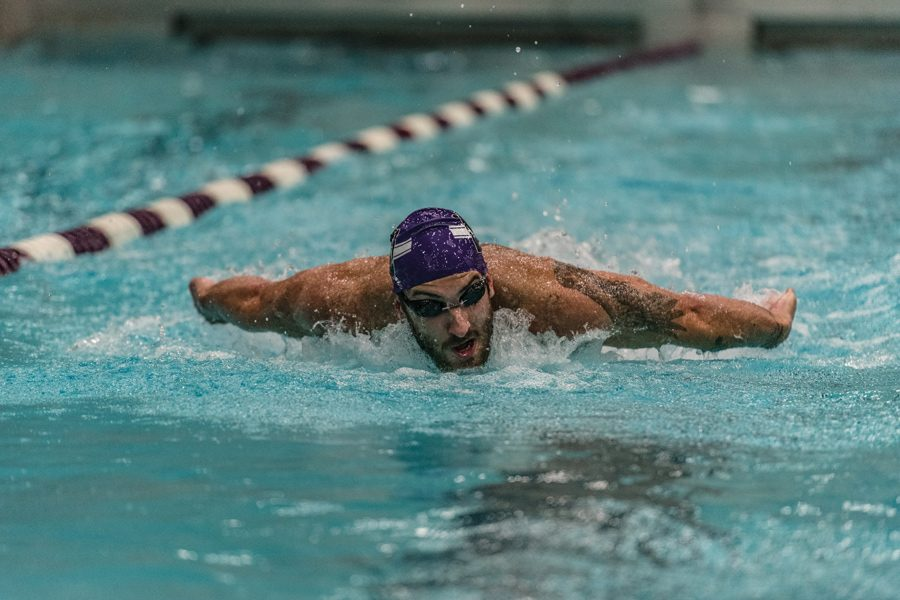 Nick+Peterson+takes+a+stroke.+The+senior+helped+Northwestern+pick+up+its+fourth+dual+meet+win+of+the+season+this+weekend+at+SMU.