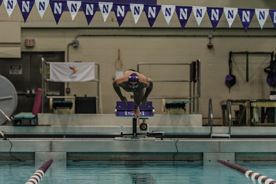 Nick Petersen dives into the pool. The senior with race in his final home meet Friday against Iowa.