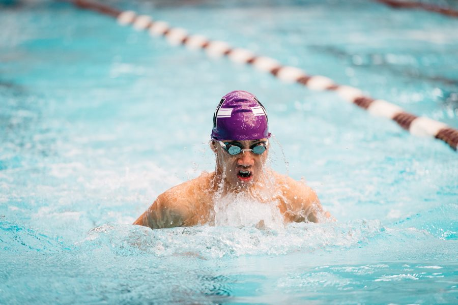 A Northwestern swimmer takes a breath. The Wildcats lost to Iowa on Senior Day on Saturday.