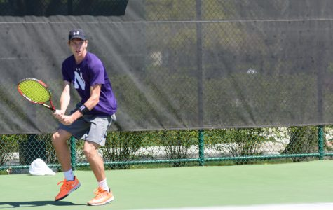 Ben Vandixhorn prepares to hit a backhand. The junior will head to Durham looking to pull an upset over a top-25 team.