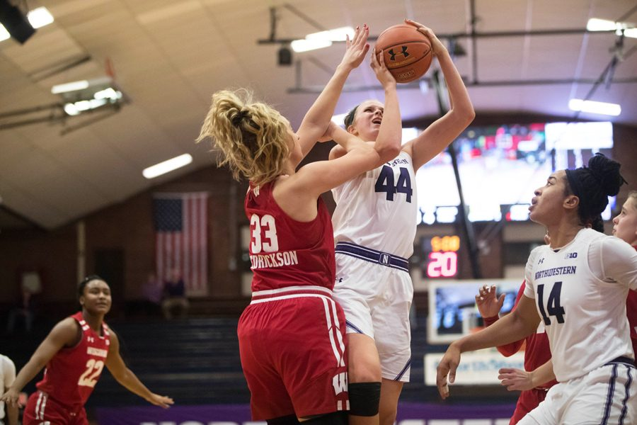 Abi+Scheid+takes+a+contested+shot.+The+sophomore+had+18+points%2C+but+it+wasn%E2%80%99t+enough+for+the+Wildcats+to+overcome+Michigan.