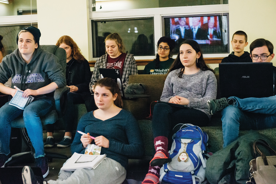 Students watch the State of the Union address in Communications Residential College. Trump focused on immigration and foreign policy, but some students said they wished he would have mentioned more social issues.