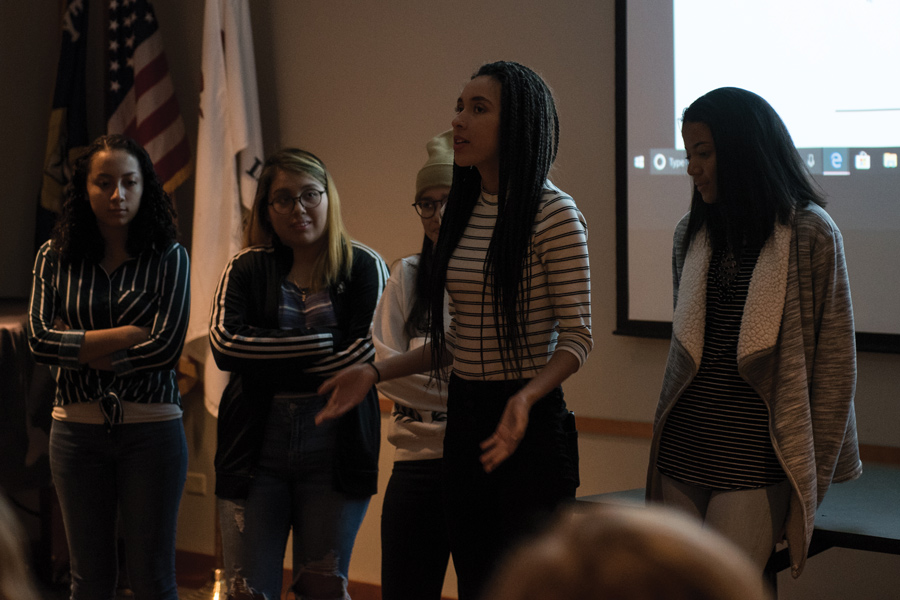 "Five Evanston Township High School students present at Evanston Public Library. The students displayed their ""photovoice"" projects — where photos are hung beside captions expressing the artist's intent."