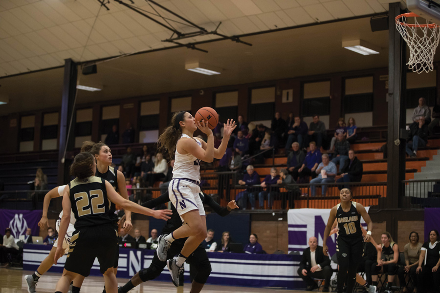 Byrdy Galernik takes a floater. The sophomore guard will look to help NU win its second conference game Thursday against Wisconsin.