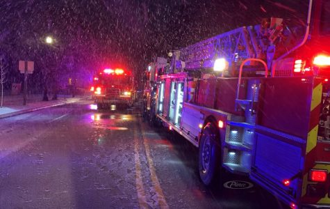 Two firetrucks arrive to put out a blaze on Tuesday morning. EFD first arrivers encountered heavy smoke and fire coming from the rear of the building.