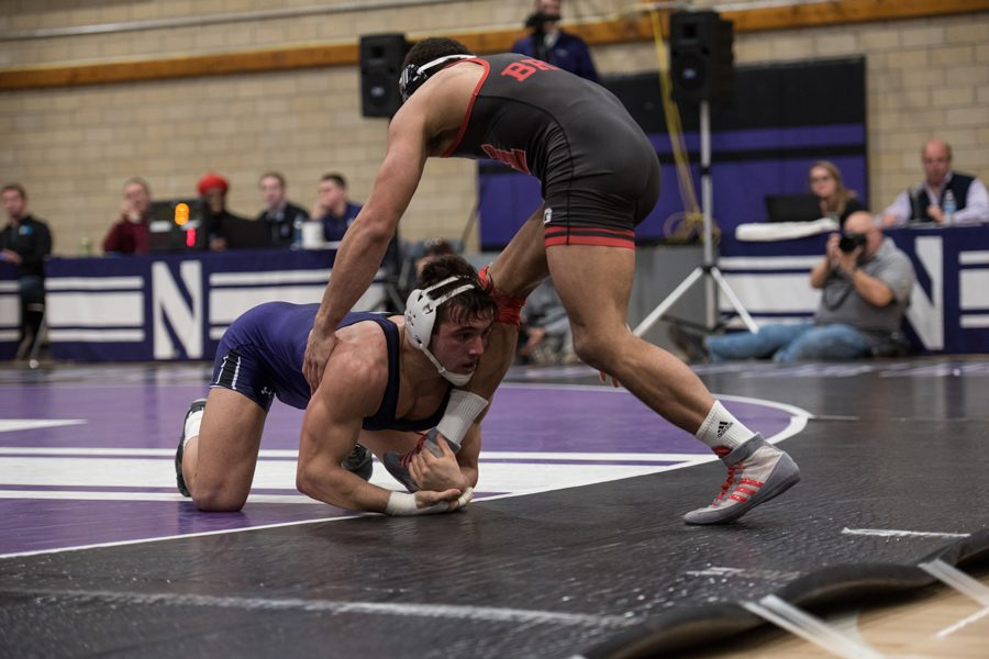 Johnny+Sebastian+struggles+for+a+takedown.+The+junior+pulled+out+a+major+decision+victory+against+Nebraska%2C+but+Northwestern+still+fell+to+the+Cornhuskers.