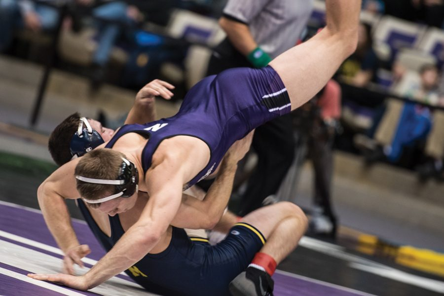 Mitch+Sliga+grapples+with+an+opponent.+The+senior+hopes+to+help+the+Cats+win+their+second-straight+ranked+conference+showdown+against+Nebraska+on+Friday.