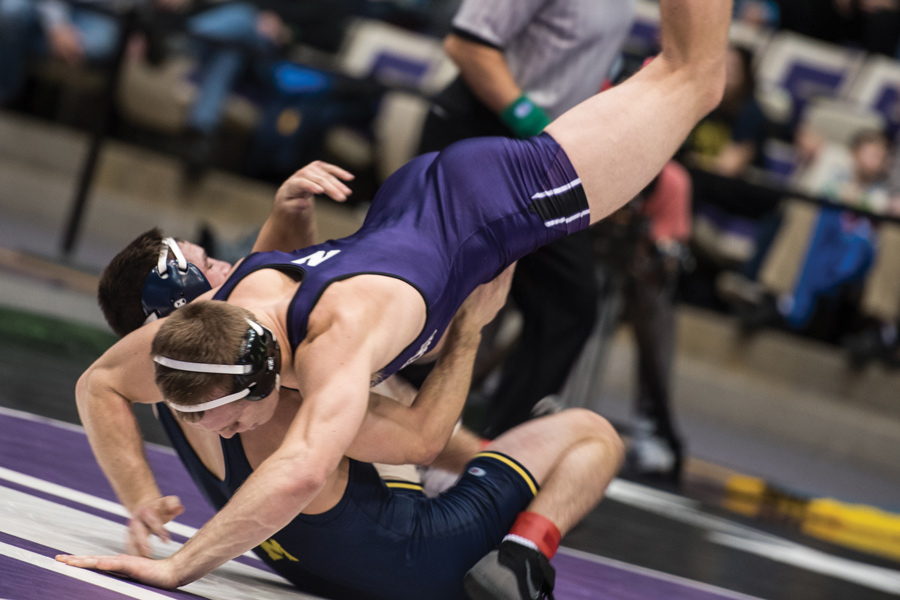 Mitch Sliga grapples with an opponent. The senior hopes to help the Cats win their second-straight ranked conference showdown against Nebraska on Friday.
