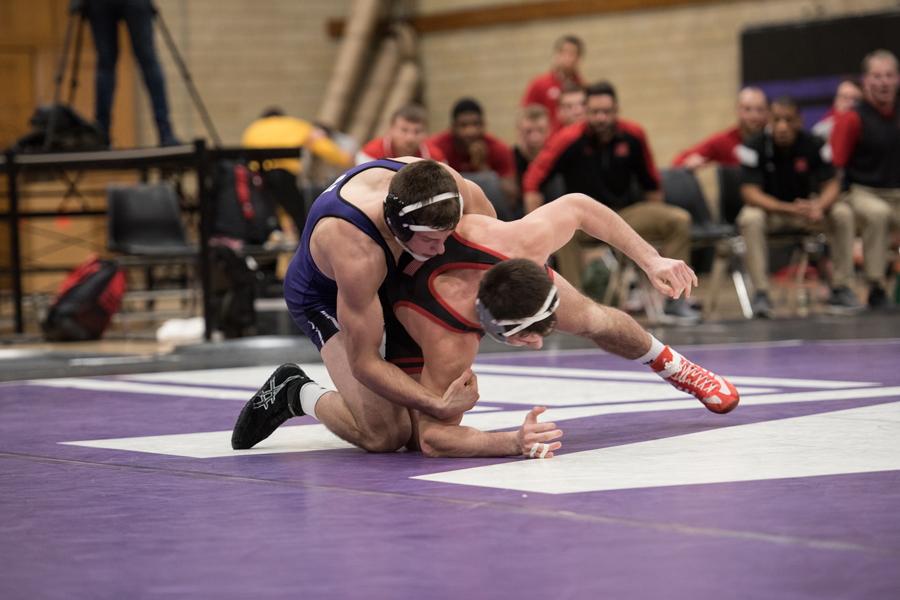 Ryan Deakin grapples with an opponent. The redshirt freshman came up with a match-winning pin against Minnesota on Sunday.
