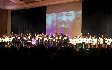 """Evanston students gather onstage for the finale of Diverse Communities United in 2017. This year's event focused around the theme """"I am deliberate and afraid of nothing"""" — a line from one of Audre Lorde's poems."""