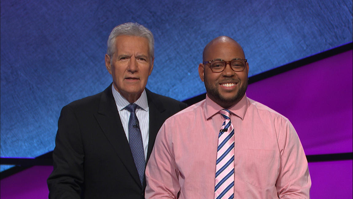 Brandon Brooks (Weinberg '04) poses with 'Jeopardy!' host Alex Trebek. Brooks competed for three days, completing two come-from-behind victories.