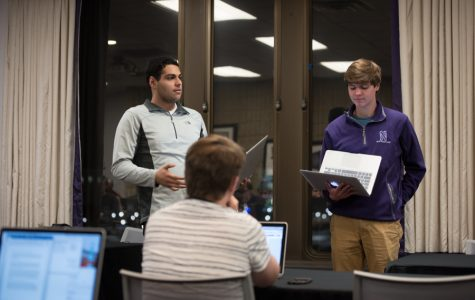 Senators Bassel Shanab and Emerson Carlson introduce a textbook affordability resolution at Wednesday's Senate meeting. The resolution said the University should consider more affordable options for class materials.