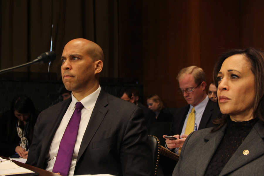 Sens. Cory Booker (D-N.J.) and Kamala Harris (D-Calif.) listen during a Senate Judiciary Committee hearing on Thursday. Senators narrowly approved Northwestern alumnus Michael Brennan (School of Law '89) to a federal judge position 11-10.