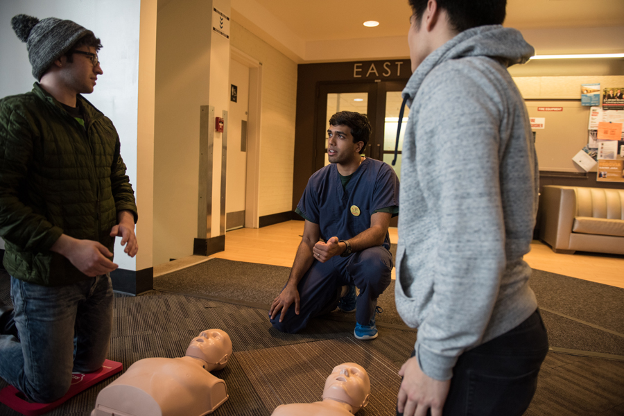Texas medical student Shyam Murali teaches Texas Two Step CPR to passersby in Foster-Walker Complex. The training event was part of a national effort to increase knowledge of bystander intervention technique.