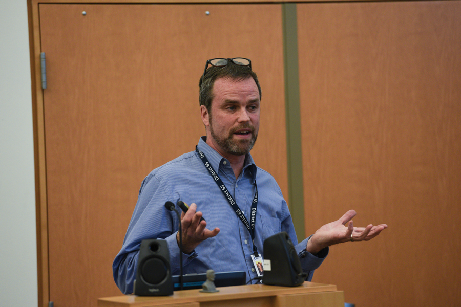 EvanSTEM director Kirby Callam gestures at the Evanston/Skokie School District 65 school board meeting on Monday. Callam updated board members on the goals of the program.