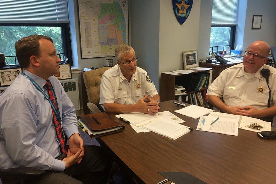 (From left) City corporation counsel Grant Farrar, Evanston police chief Richard Eddington and Cmdr. Joseph Dugan discuss a court case. Farrar submitted his resignation and will leave the city staff in April.