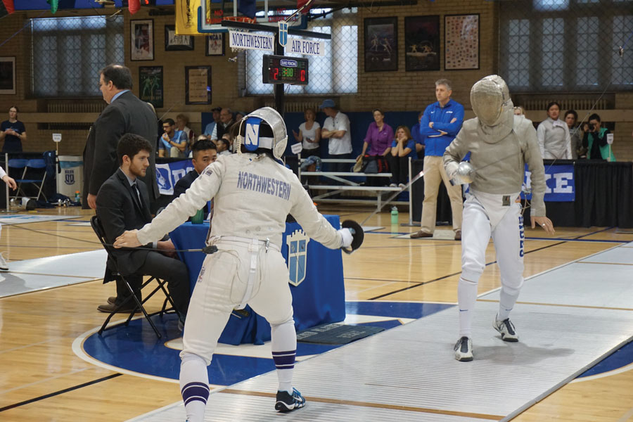 A Northwestern fencer prepares to square off with an opponent from Air Force. Six Wildcat fencers competed in the Junior Olympics over the weekend.