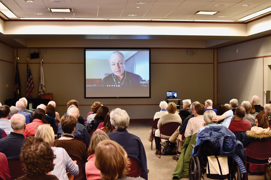 "James Tusty video calls into an event at EPL on Saturday. Tusty is one of the filmmakers of ""The Singing Revolution."""