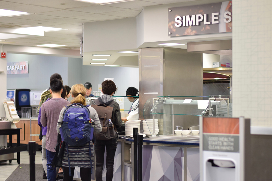 Students wait in line to get food at Sargent Dining Hall. Several groups on campus, including student organizations and administrative departments, have been addressing food insecurity on Northwestern's campus.