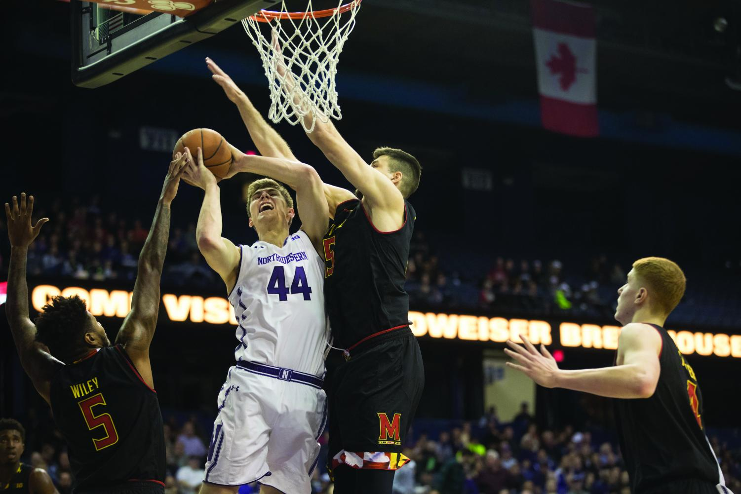 Gavin Skelly finishes a layup. The senior led the Wildcats with 15 points, but they fell after Maryland's late run.