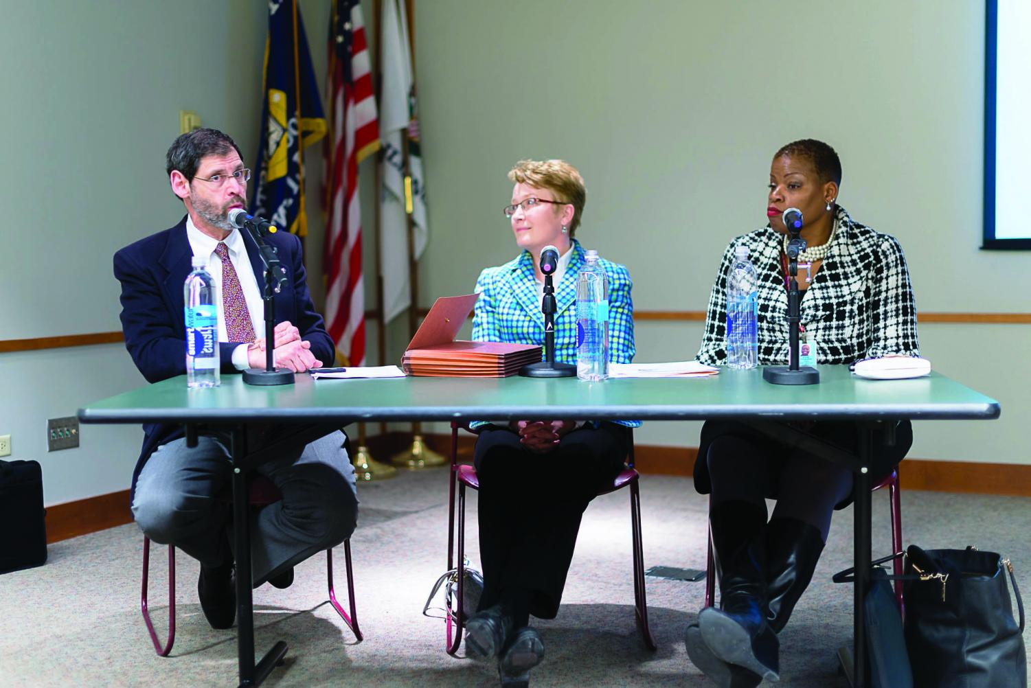 Evonda Thomas-Smith (right) on a panel in 2014. Thomas-Smith will be honored for her contributions to public health at an event Friday.