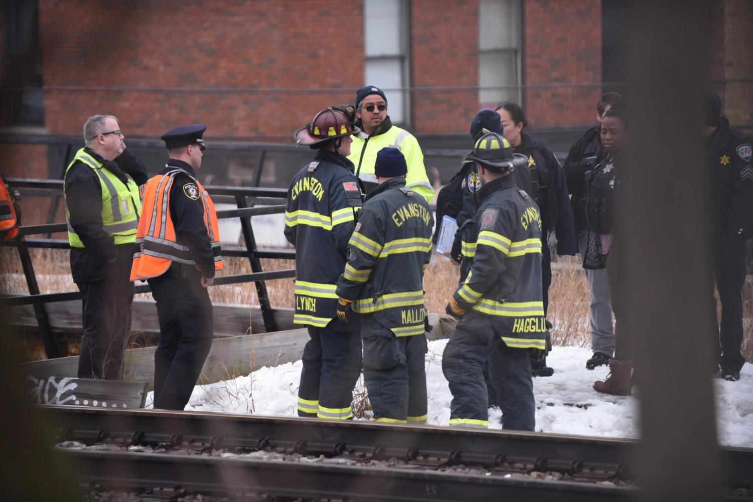 Officials work on the Metra tracks Thursday morning.