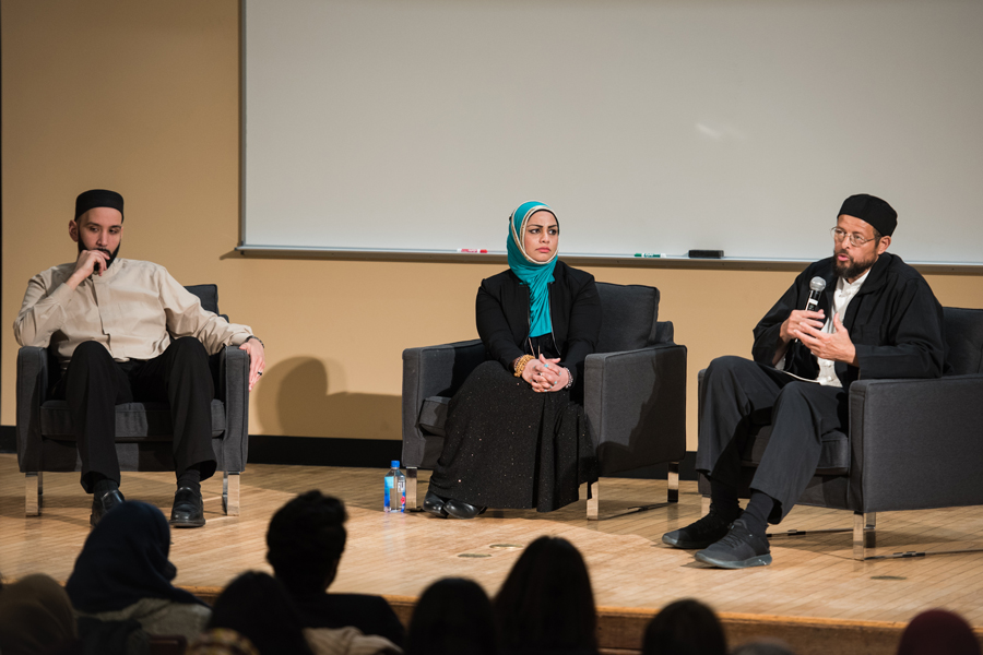 Muslim scholars Zaid Shakir and Omar Suleiman talk to audience during a Q&A session moderated by University associate chaplain Tahera Ahmed. The two speakers emphasized using faith as fuel for personal achievements.