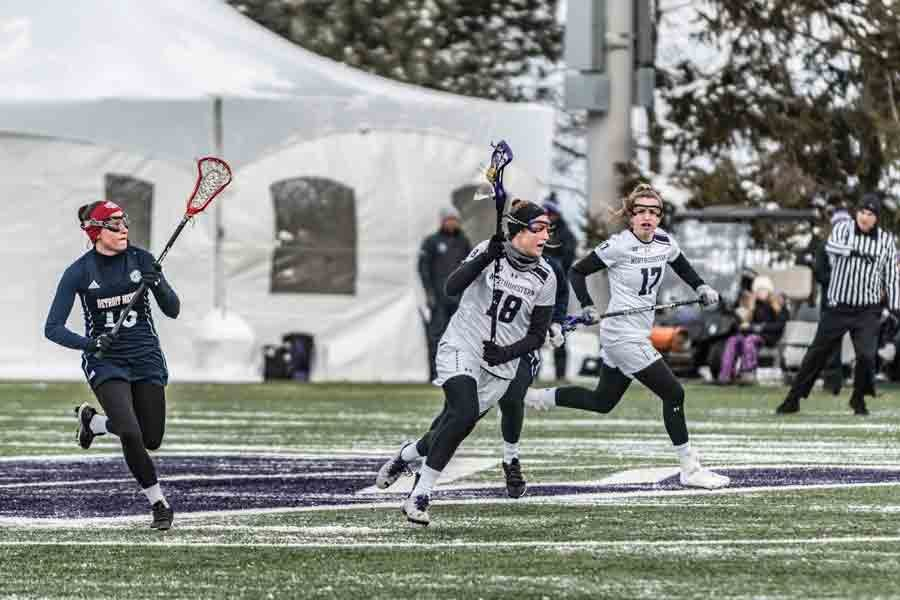 Kim+Harker+and+Taylor+Pinzone+look+to+attack.+The+Northwestern+attack+lit+up+Colorado+for+15+goals+before+falling+at+Duke.+