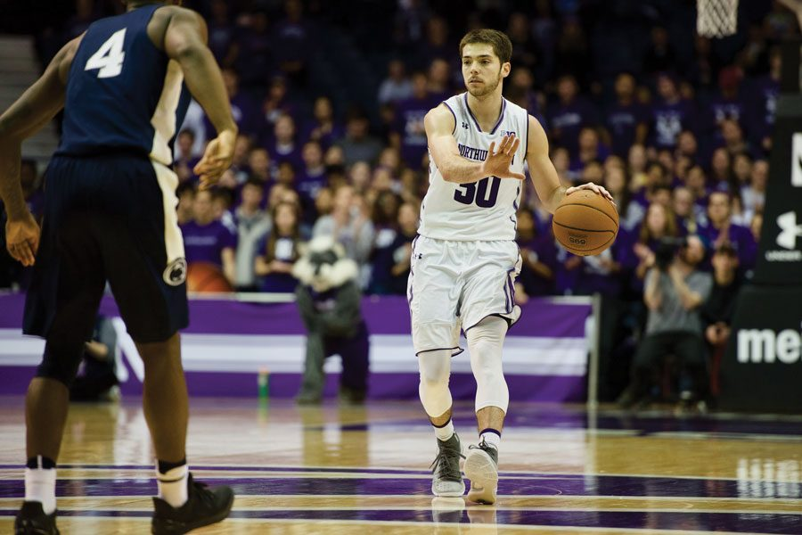 Bryant McIntosh brings the ball up. The senior guard leads a Wildcats squad searching for more crucial victories against Maryland.