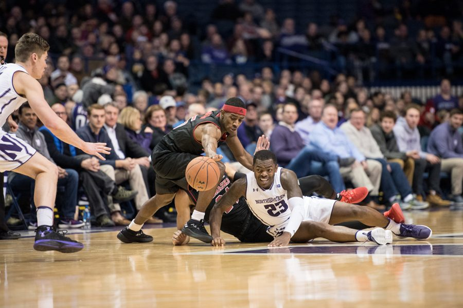 Jordan Ash dives for a loose ball. Ash and the Wildcats will face off against No. 2 Michigan State on Saturday.