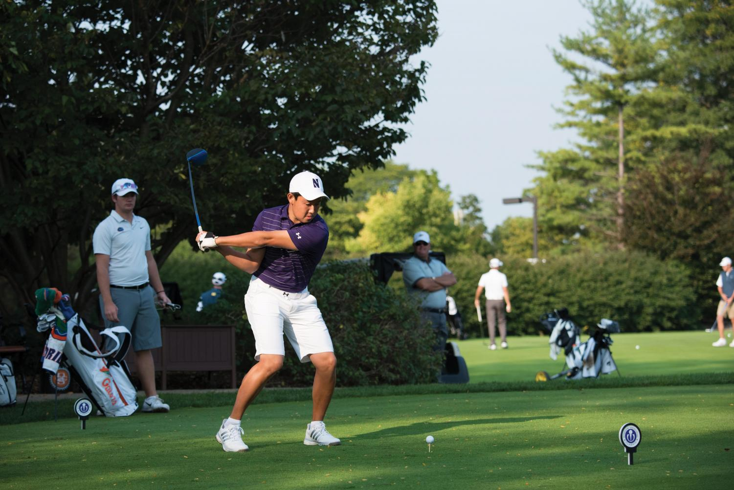 Dylan Wu tees off. The senior and the Wildcats struggled at Big Ten Match Play, finishing 11th.