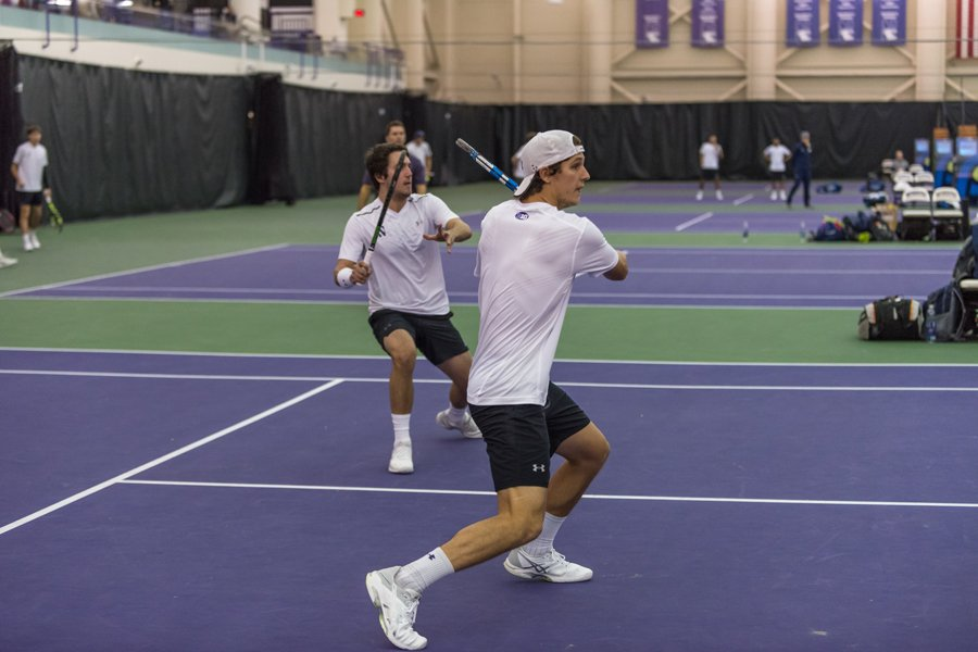 Chris Ephron (right) and Antonioni Fasano (left) attack the net. The duo teamed up for the first time last weekend against Oklahoma State.