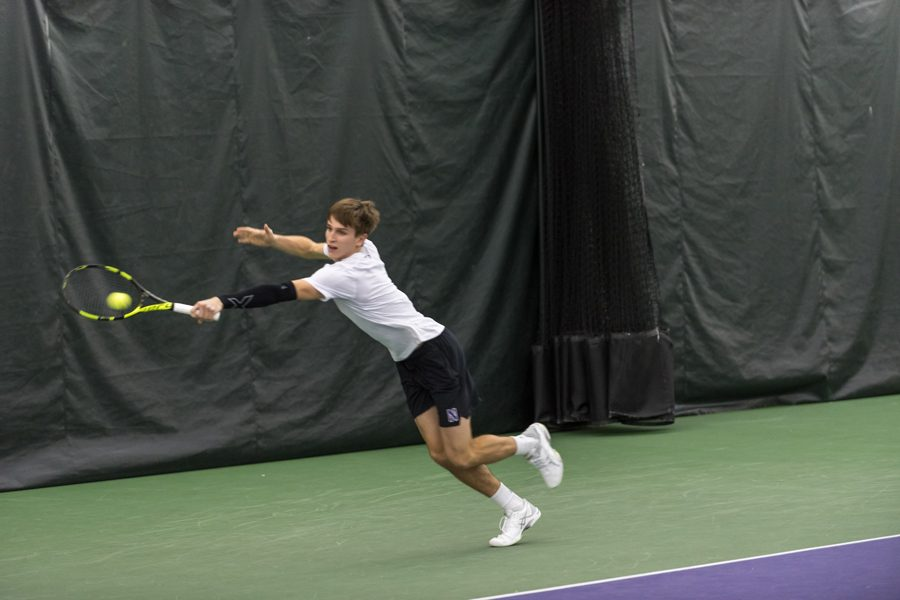 Ben+Vandixhorn+dives+for+a+backhand.+The+junior+will+look+to+help+the+Wildcats+to+their+first+ranked+win+of+the+season.
