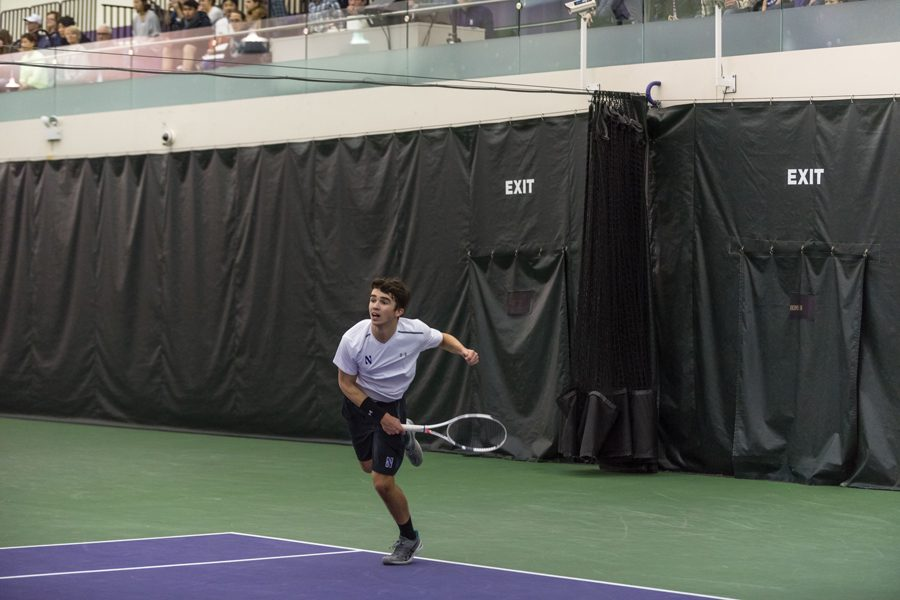 Nick Brookes follows through on a serve. The freshman struggled at the No. 2 singles spot for the Wildcats last weekend.