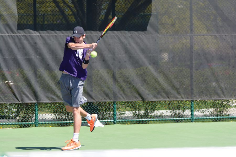 Ben+Vandixhorn+follows+through+on+a+backhand.+The+junior+and+the+Wildcats+had+a+tough+time+Sunday+against+Duke.+