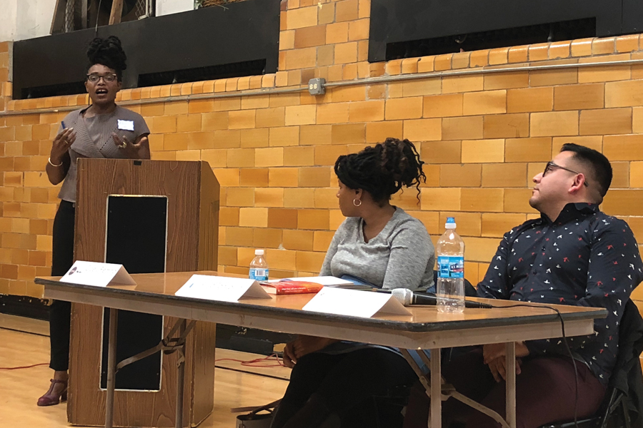 Moderator Stacey Gibson introduces the panel. Gibson facilitated a discussion about institutionalized racism in Evanston/Skokie District 65.