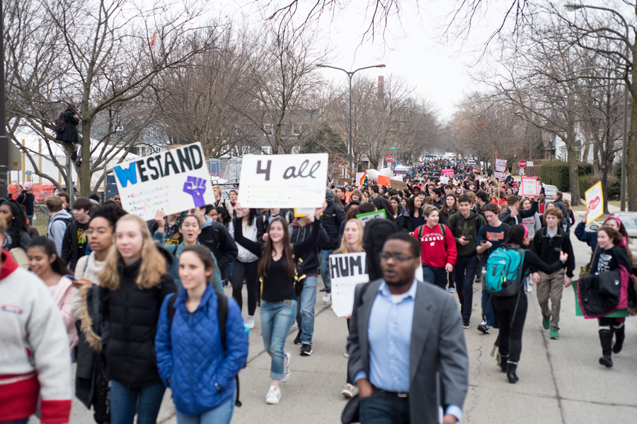 Students at Evanston Township High School protest President Donald Trump's inauguration last winter. ETHS students are planning a walkout in support of gun control on March 14.