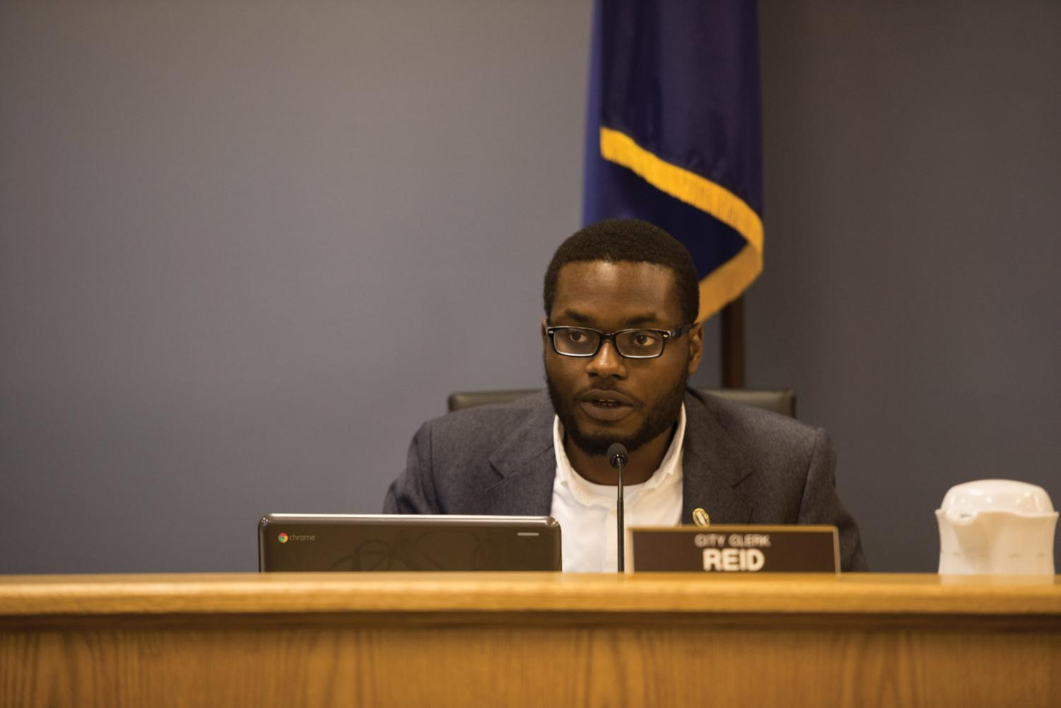City clerk Devon Reid at a City Council meeting. Reid was arrested Tuesday for violating traffic laws and driving with a suspended license.