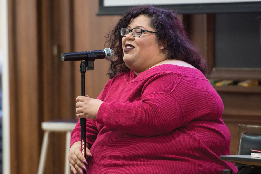 """Yesika Salgado performs at Harris Hall on Thursday. The Salvadoran poet read from her new book, """"Corazón,"""" and spoke about love, community and identity."""