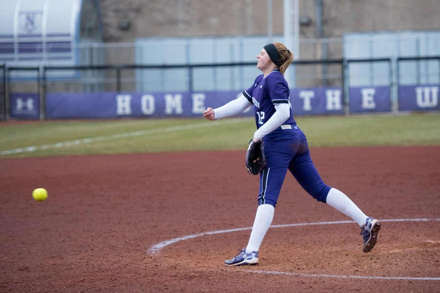 Kenzie Ellis delivers a pitch. The junior pitcher will look to step up in the possible absence of fellow pitcher senior Kaley Winegarner this weekend.