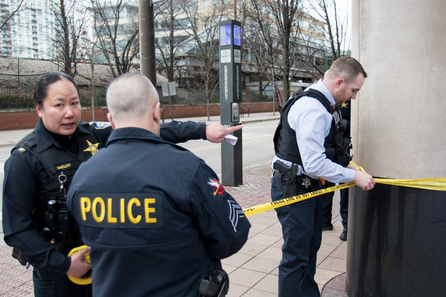 Police section off an area with crime scene tape. Evanston Police Department announced on Sunday that it had charged two men in connection with the homicide of Yakez Semark.