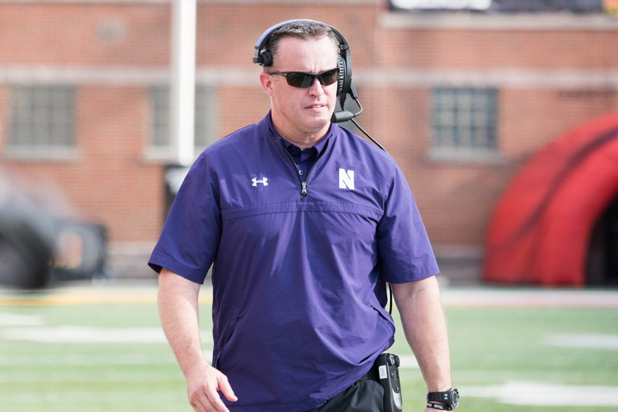 Pat Fitzgerald wanders the sidelines. Fitzgerald and Northwestern signed 18 scholarship players in the class of 2018.