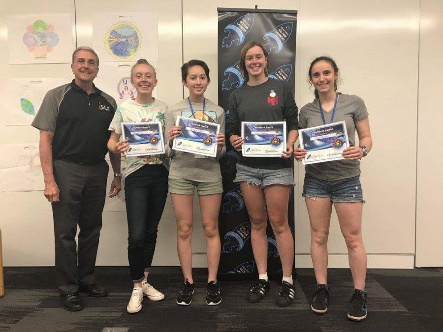 Evanston Township High School junior Sarah Bloom and her team after winning a competition. Bloom said her team's experiment will be launched into space sometime this summer.