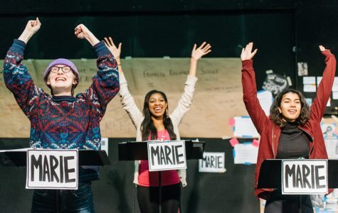 """The cast of """"Marie in Tomorrowland"""" rehearses in the Mussetter-Struble Theater. The musical follows the repercussions of Marie Curie's work with radiation in a post-nuclear world."""