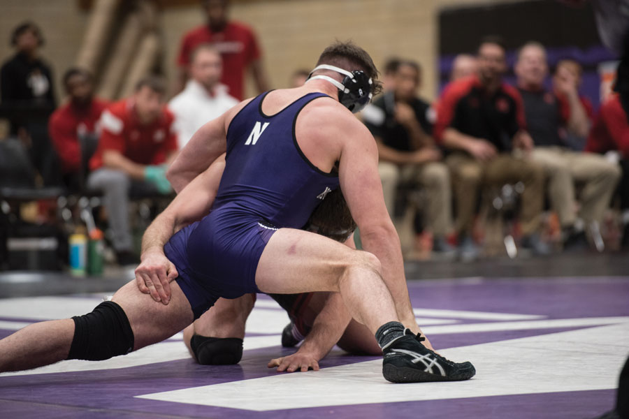 Zach Chakonis battles with an opponent. The sophomore pinned his opponent in the Wildcats' beatdown of SIU-E.
