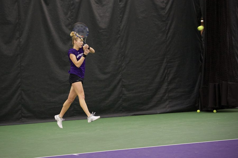 Maddie+Lipp+swings+through+a+backhand.+The+senior+played+a+key+role+in+the+Wildcats%E2%80%99+win+over+No.+7+Vanderbilt