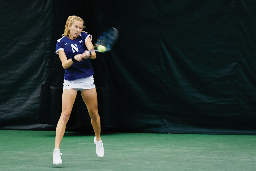 Maddie Lipp hits a backhand. The senior lost a close three-set match that provided the clinching point for Texas.