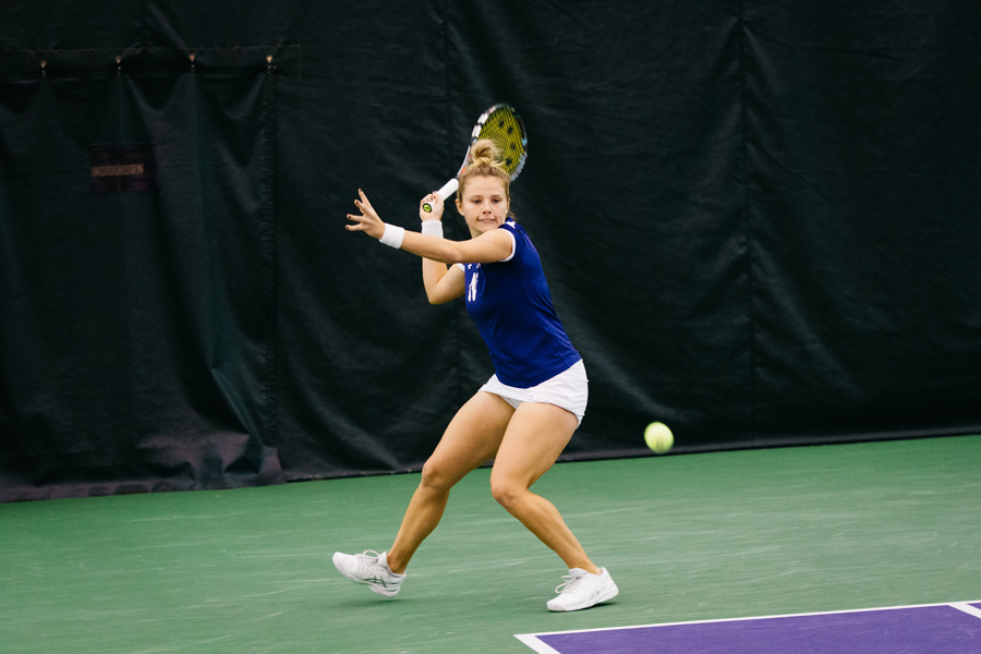 Caroline Pozo prepares to strike a backhand. The freshman and the Wildcats take on No. 11 Texas on Sunday in a battle of ranked teams.