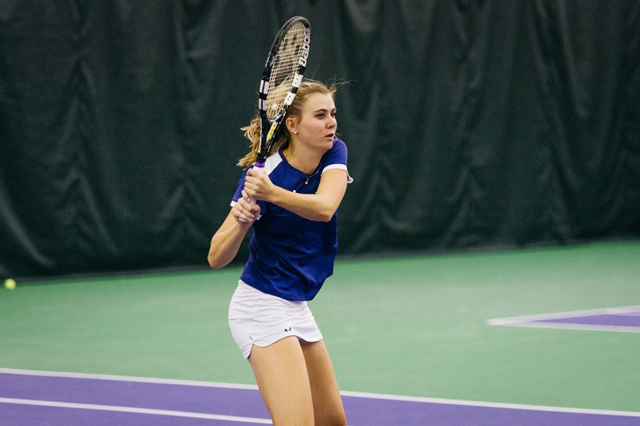 Erin+Larner+follows+through+on+a+backhand.+The+senior+dropped+a+tense+final+singles+match+in+the+Wildcats%E2%80%99+loss+to+Oregon.