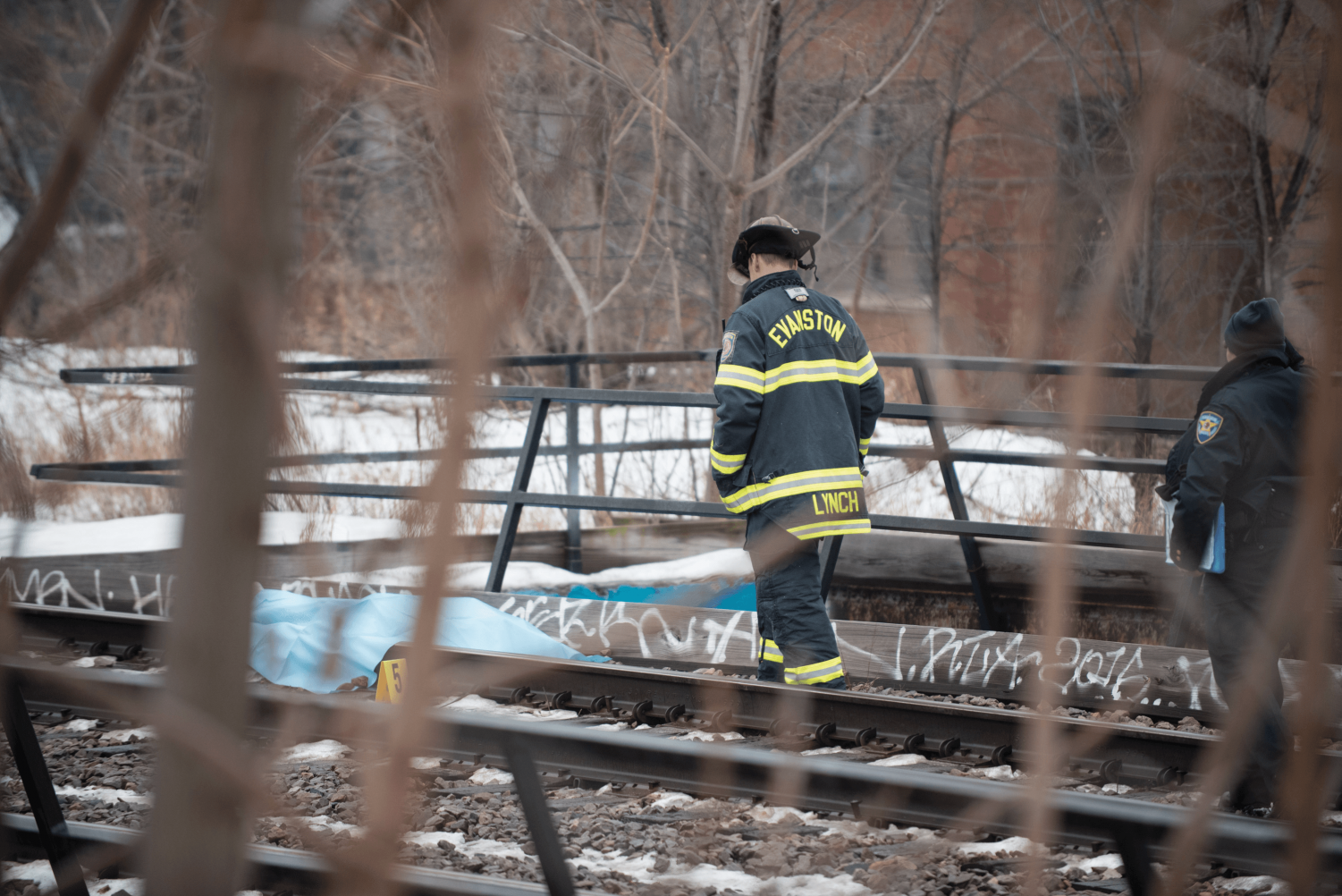 Evanston Fire Department firefighters investigate the Metra line. Evanston Police Department identified Monday the body of a man found near the Metra tracks.